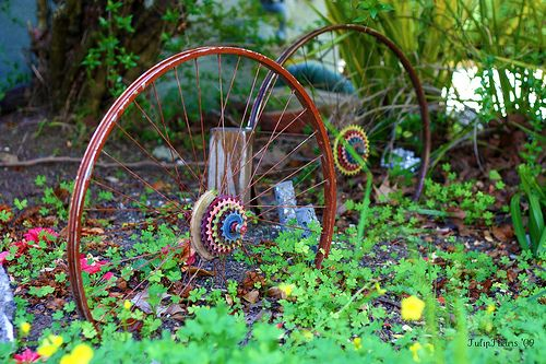 More fun with old bike wheels, rims with brightly painted gears.