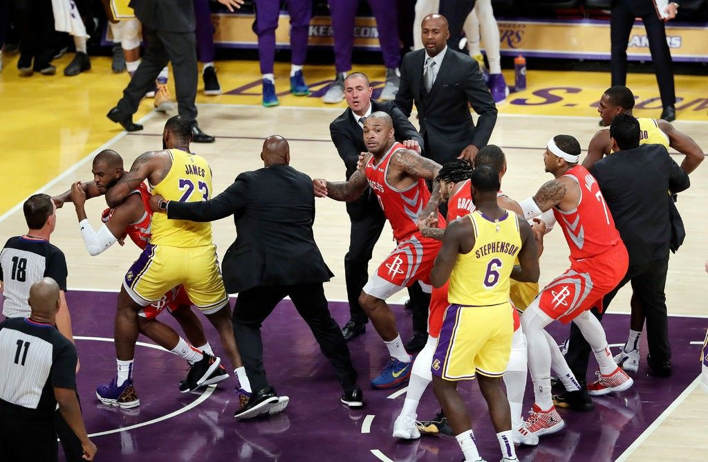 lakers and rockets let fists fly in lebron james s first home game rh pinterest com