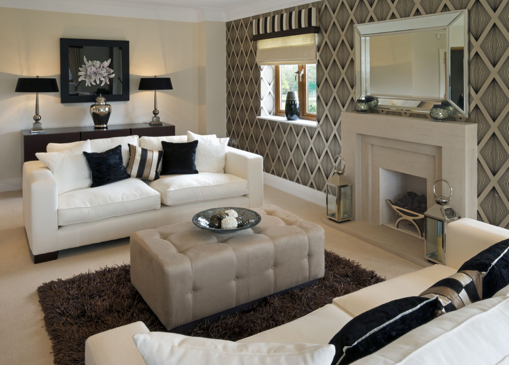 Modern Look Living Room Features White Sofas With Dark Decorative Pillows  Facing Over Rectangular Grey Ottoman