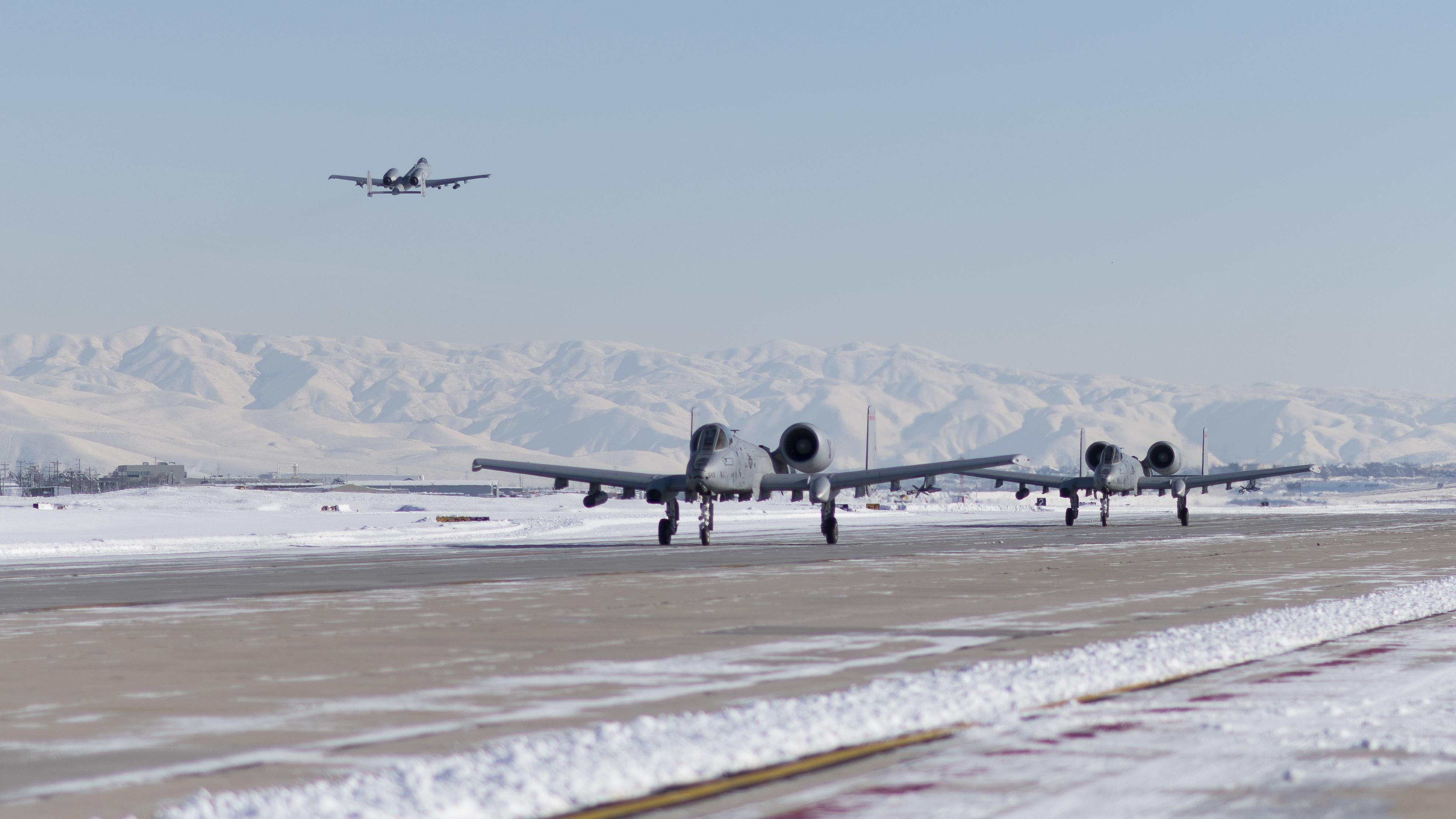 An A-10C Thunderbolt II from the 190th Fighter Squadron takes off for a training mission shortly after a snowstorm Jan. 6 2017 at Gowen Field Idaho. [3952x2223]