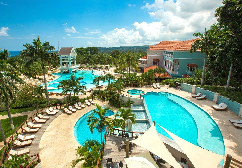 Encompassing Over 100 Acres Sandals Ochi Beach Resort Is A True Garden Of Eden Choose Between Sandals Ochi Beach Resort Caribbean Beach Resort Beach Resorts