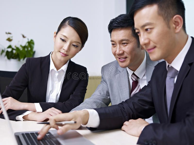 Asian Business People A Team Of Asian Business People Working