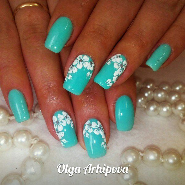 A bright spring manicure made by turquoise gel lacquer, decorated with  snow-white flowers. This contrasting combination of colors allows you to  create an i - Nail Art #1270 - Best Nail Art Designs Gallery Pinterest Bright