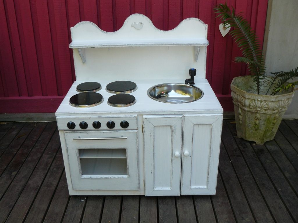 A toy kitchen unit and stove made by Richard and techniqued by Toni ...