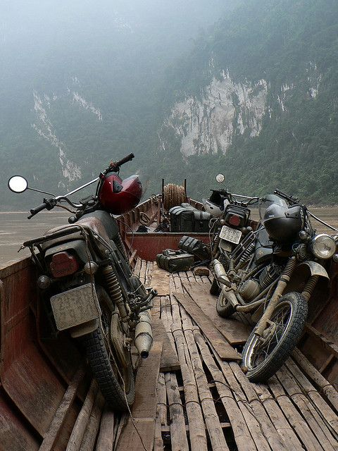 south east asia. motorcycles on a boat.