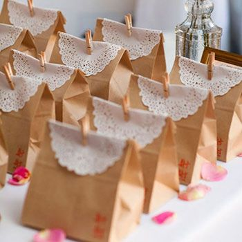 I just love a quick and easy party favor idea, like these sweet paper bags trimmed with doilies! They're from a wedding featured on Style Me Pretty. To add a little personalization, there's a red stamp in the lower right-hand corner of each bag, and ...