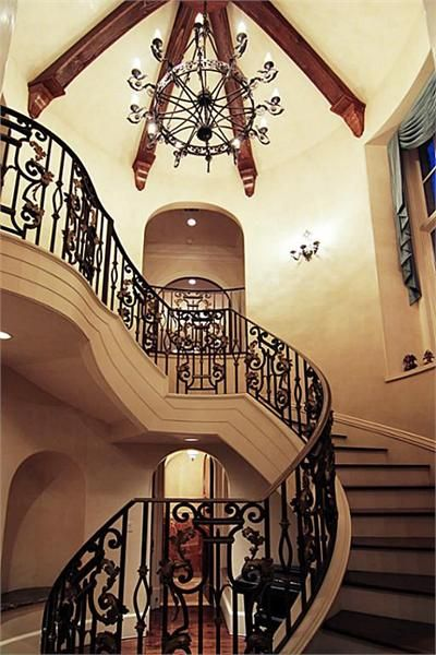 SPIRAL STAIRWAY   Spectacular Banister W/ Custom Ironwork And Wall Sconces  Bejewel The Staircase Inviting One From The Stair Hall, Marble Topped Art  Niches, ...