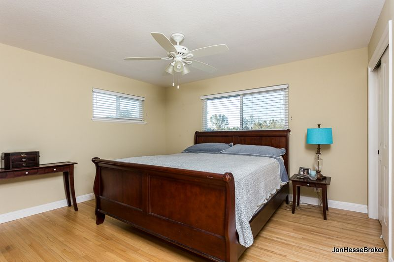 Custom paint and wall to wall wood floors accentuate this secondary bedroom.