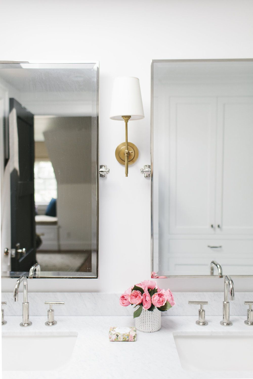 And cabinet pulls with antique brass sconces and a chrome faucet - Brass Sconces Studio Mcgee