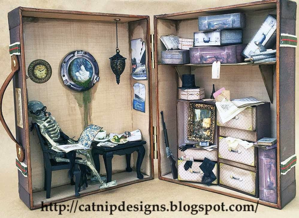 artistic catnip: a haunted sunken ship shadowbox in a miniature suitcase...