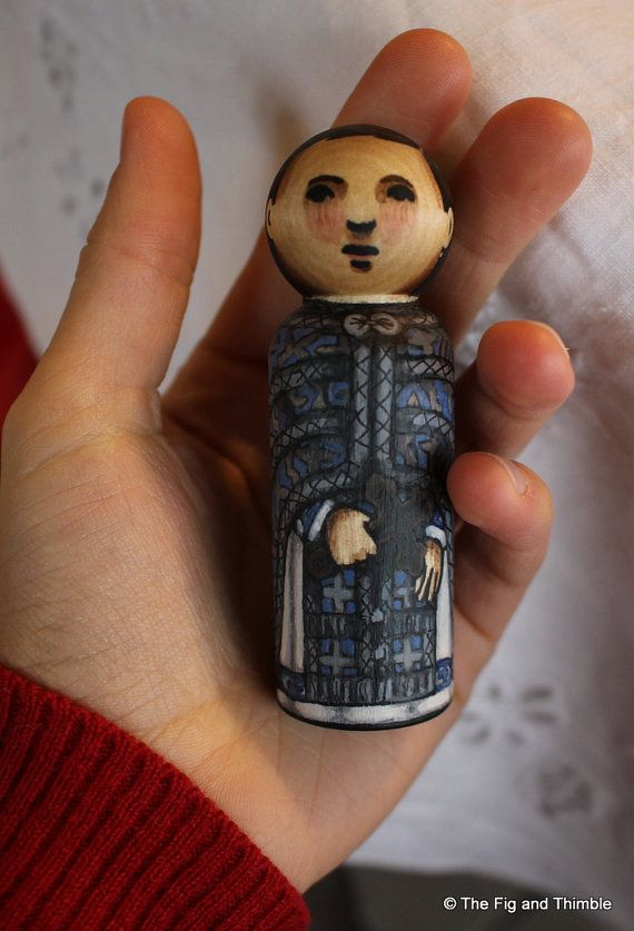 Transfer this priest to your local block town! This is a hand painted wood peg doll Byzantine priest. He is wearing traditional blue and silver vestments and holding a cross. This listing is for the priest peg doll. Altar server sold separately. Other dolls and props not included.  This 3.5 tall wood peg doll has been detailed with archival pigmented ink and then hand painted with watercolors. This technique allows some of the wood grain to show through and gives the dolls soft, gentle…