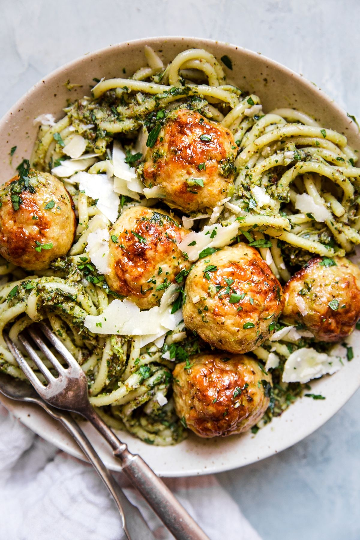 Baked Chicken Meatballs with Broccoli Pesto Pasta by The Modern Proper || With just five ingredients, these parmesan-loaded baked chicken meatballs are good any way you serve them. But, paired with a hearty roasted broccoli pesto and pesto, they make for a lovable feast.