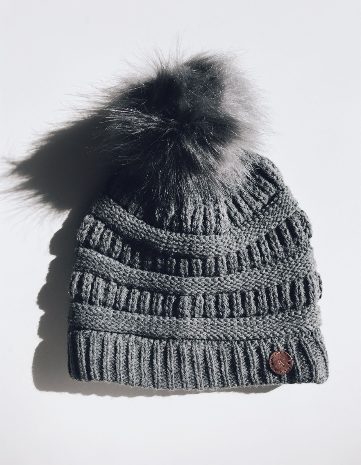 09791facde5 The perfect grey cable knit pom beanie for all your outdoor adventures.  This cozy and