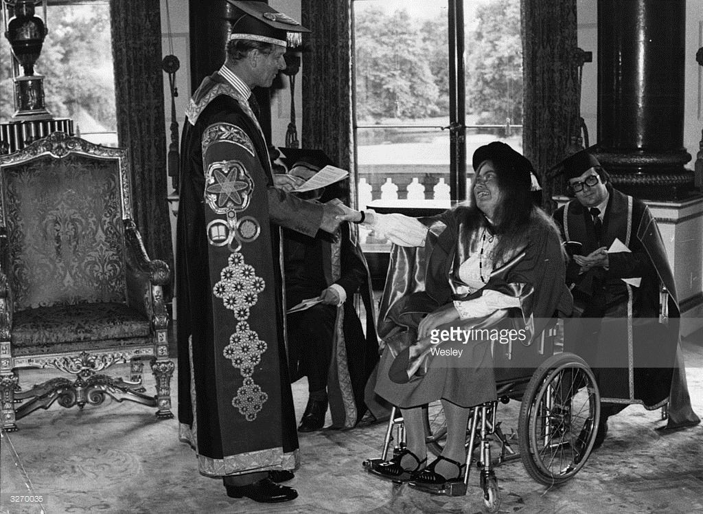 The Duke of Edinburgh shakes hands with the famous cellist, Jacqueline du Pre, after presenting her with a Salford University honorary degree in the Music room at Buckingham Palace, the first time such a ceremony had taken place at the Palace.