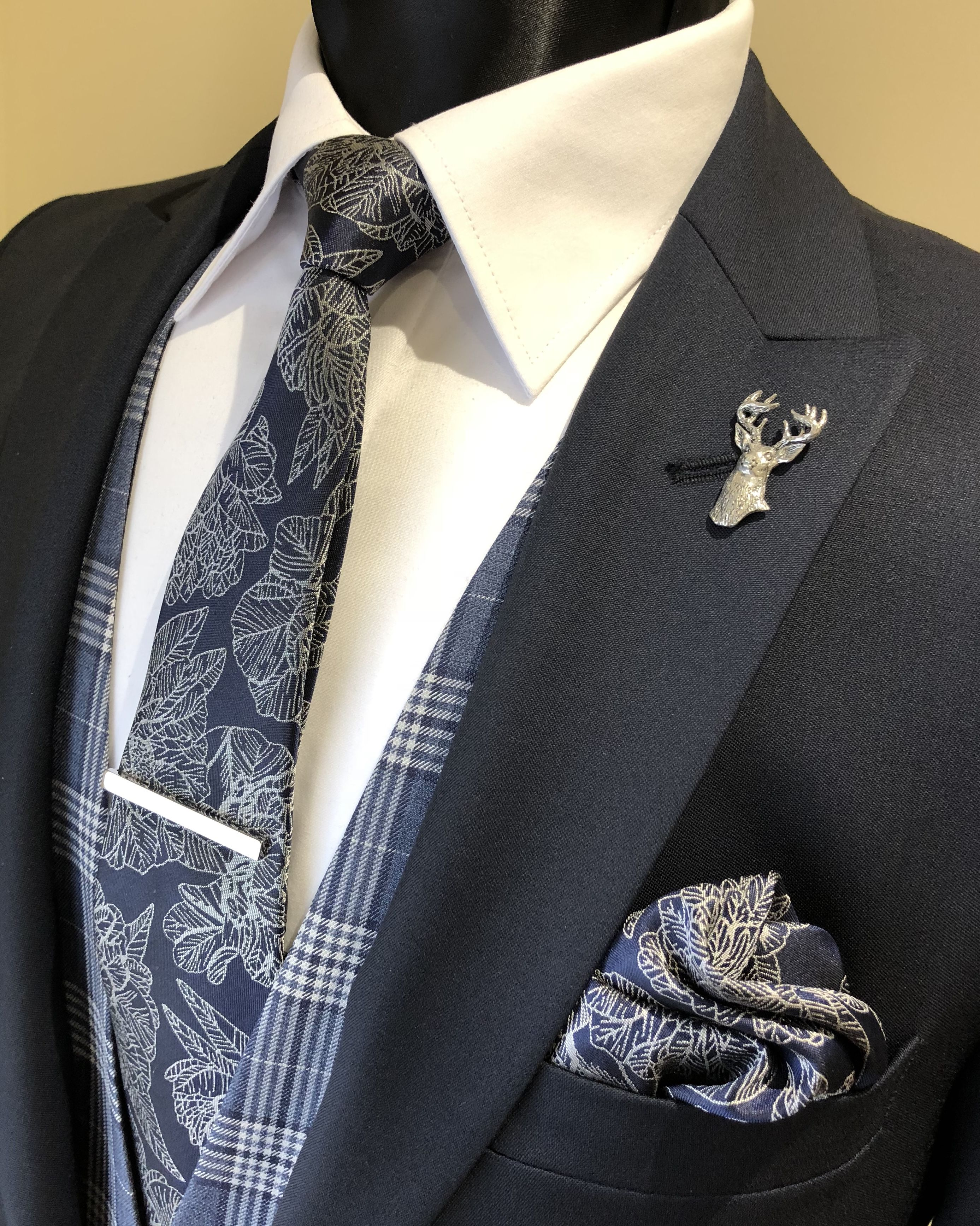 Slim fit navy lounge suit paired with a blue check