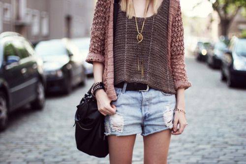 Light brown knitted sweater, knitted top, blue jean shorts.