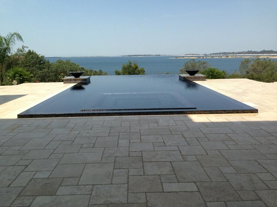 Custom Swimming Pool With Rim Flow System Custom Swimming Pool Swimming Pools Swimming Pool Hot Tub