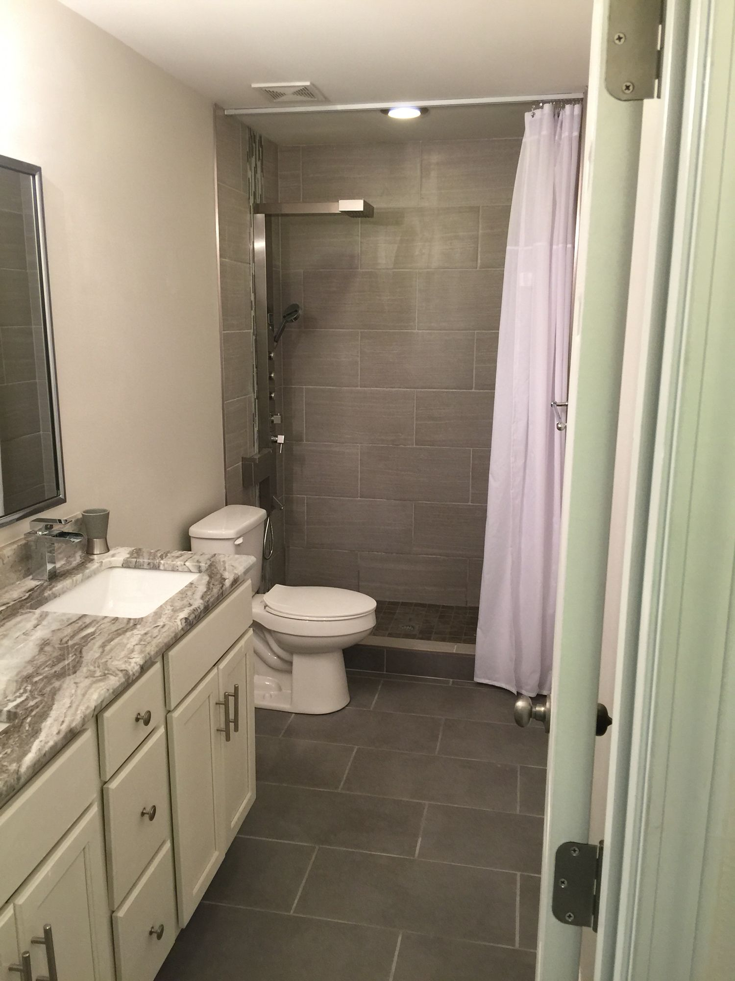 Bathroom Remodel Using 12x24 Leonia Silver Porcelain Tile, Trax Shower  Curtain, Akdy Waterfall Shower