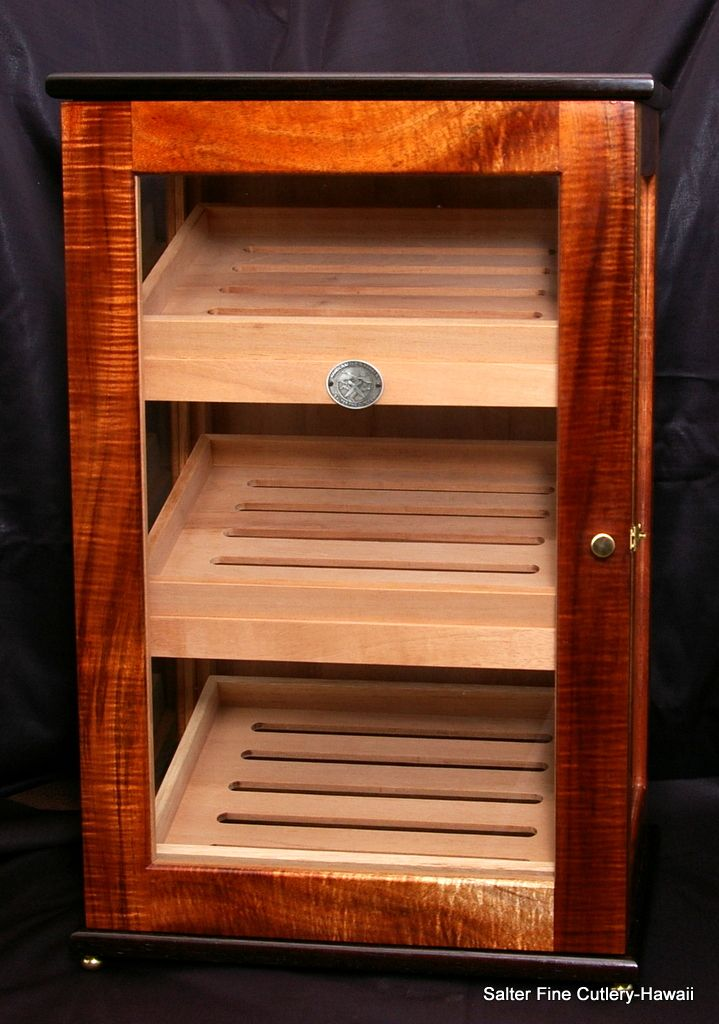 Large humidor with three glass sides. Made of Hawaiian solid curly koa wood with wenge trim and Spanish cedar interior. Handcrafted custom humidors in any size by Salter Fine Cutlery.