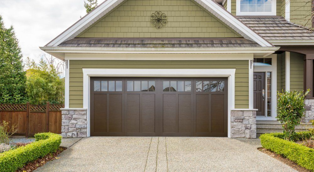 tradition carriage series insulated haas door affordable photo overlays residential res doors garage traditional steel american thomas house