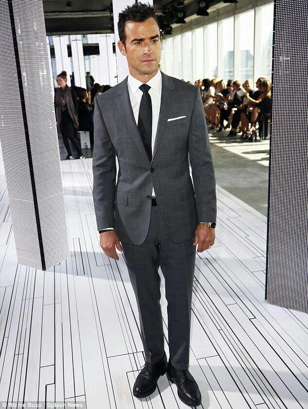Dark gray suit, white shirt, black tie, black shoes & pink