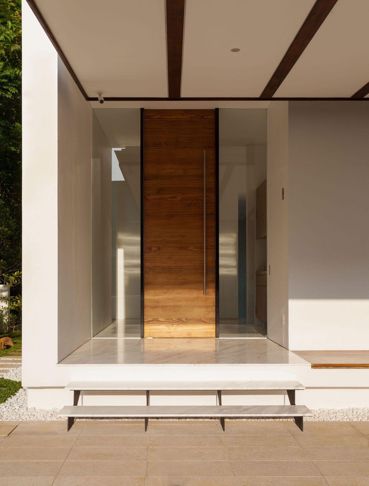 Modern entry doors with sidelights - Interior Minimalist Contemporary Home Interior Design With Courtyard Wooden Door Between Glass Window