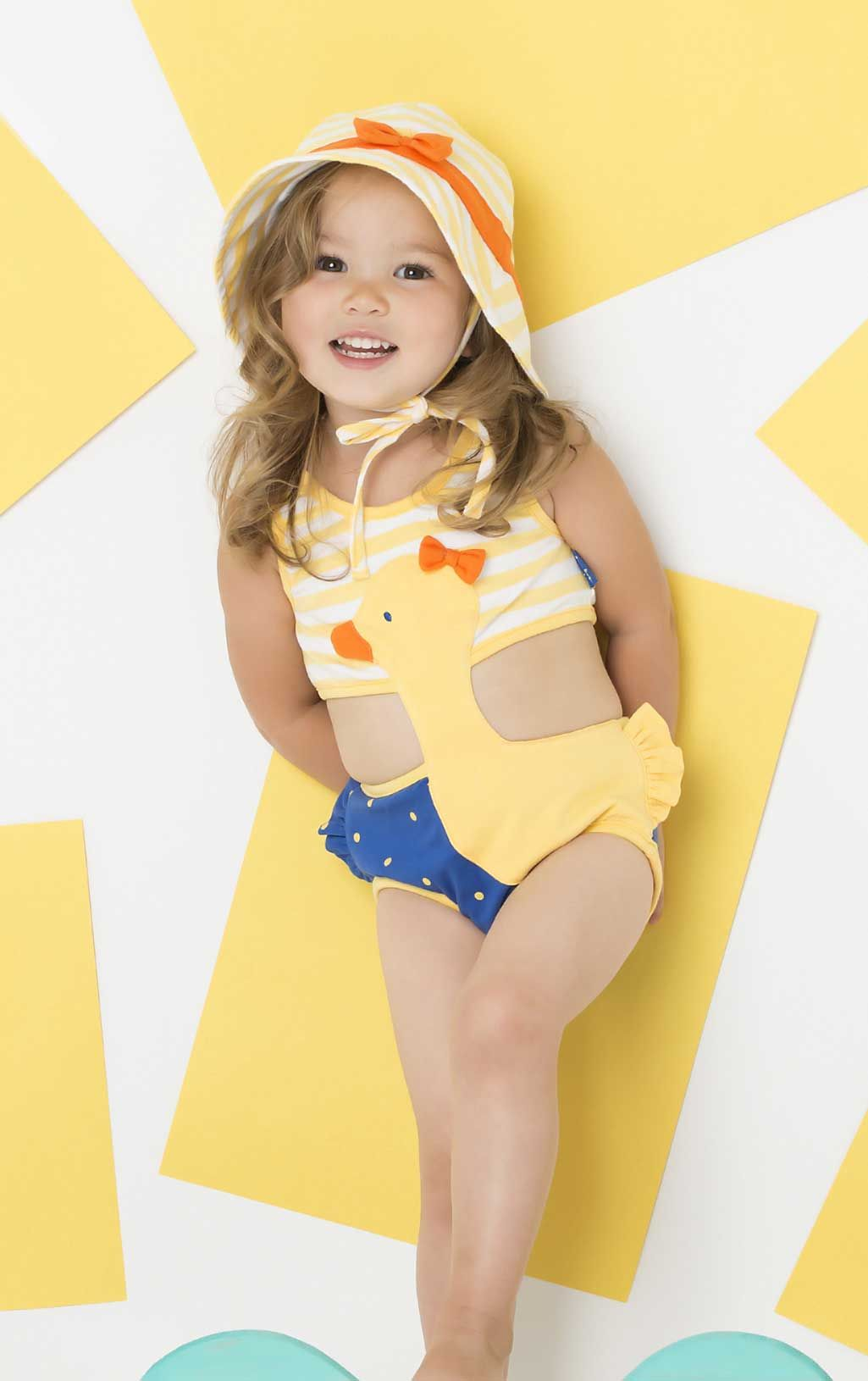 9b303ecb60909 A one piece swimsuit that looks like a two piece for little girls! This unique  girls swimsuit is available for infant and toddler girls.