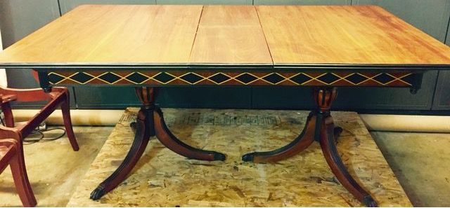Classic Duncan Phyfe style table in pecan wood. I stripped the high gloss off the top, restained it pecan but really let the gorgeous pecan grain come through. I then embellished the trim and base with black paint and a harlequin pattern. Tamarabeard1@gmail.com