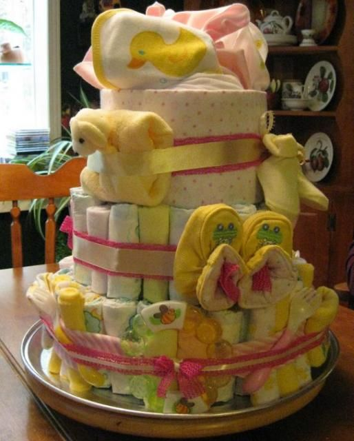 Awesome Cake Made Of Diapers For Baby Shower Part - 1: Baby Shower Cake Made Out Of Diapers And Slippers.JPG