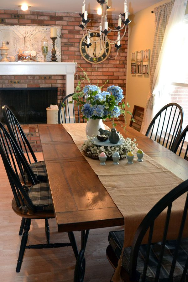 Country Style Dining Room Design Ideas With Brick Wall Accent And  Traditional Fireplace Featuring Farmhouse Dining Table