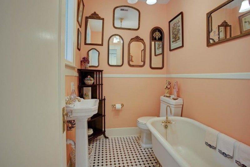 traditional bathroom idea with light orange walls decorative mirror ...