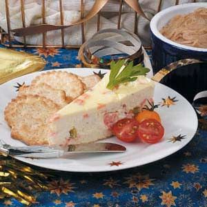 "Smoked Salmon Cheesecake - Reviewer says: ""I have taken this to many Christmas parties through out the years and it has always been a hit!! Many people have asked me for the recipe, but everyone knows I'm the one that brings it to the annual parties. I serve it up with cherry tomatoes and green olives and a variation of crackers and breads, I've also stuffed celery with it."""