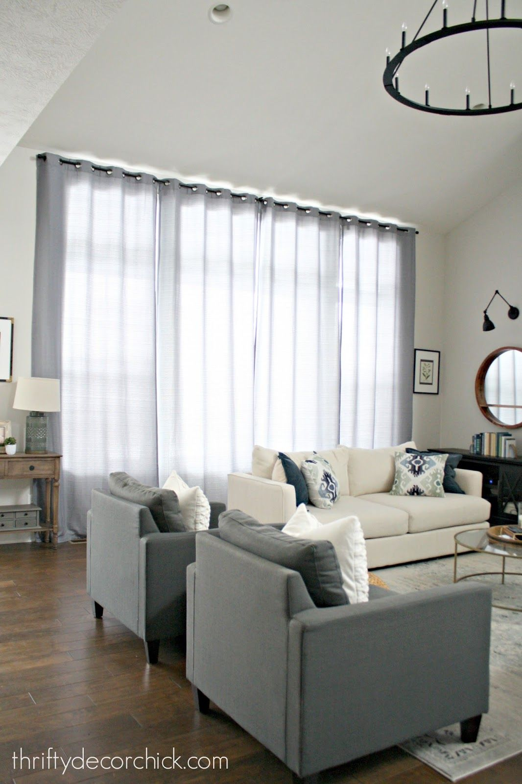 Hardware And Drapes For Big Windows That Don T Break The Bank Big Windows Living Room Long Curtains Living Room Picture Windows Living Room
