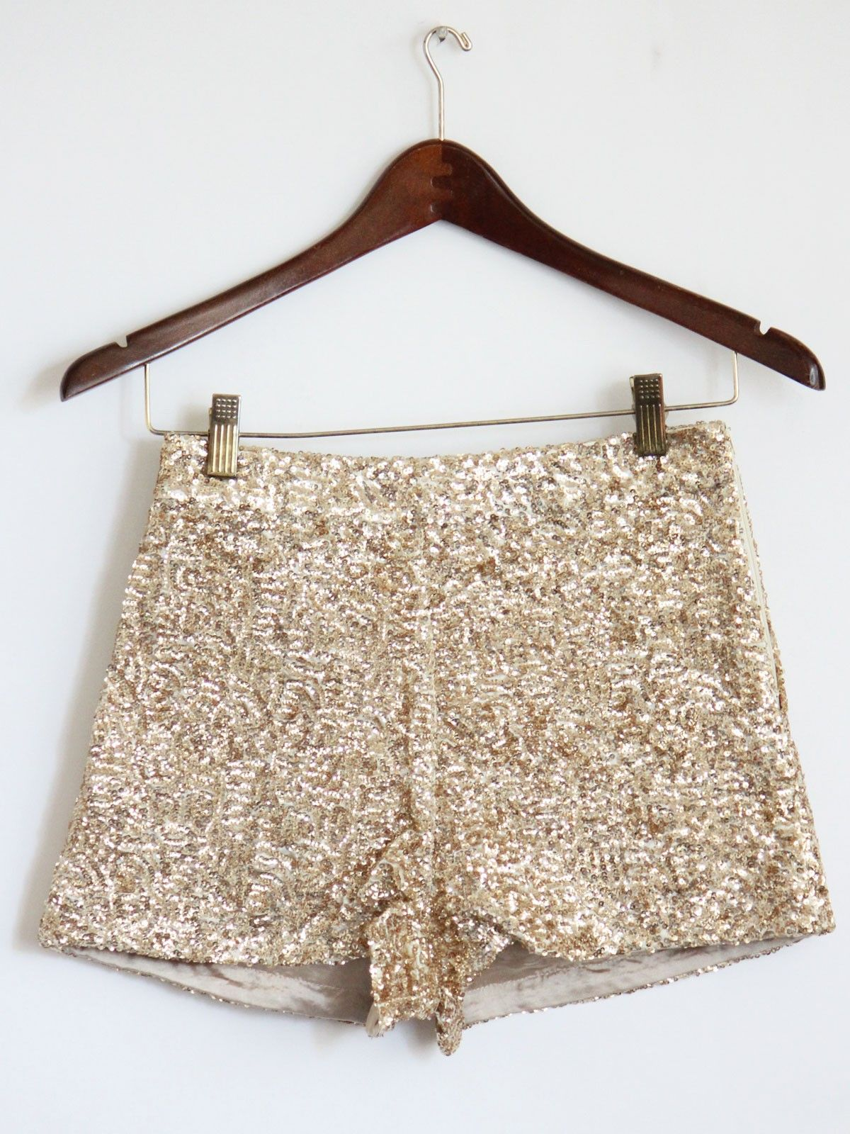 High-waisted sequined shorts.