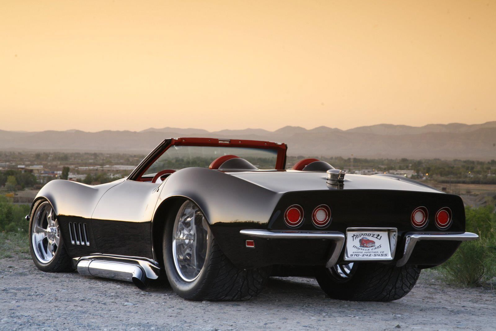 Extremely low Chevrolet Corvette C-3 with sidepipes and ...