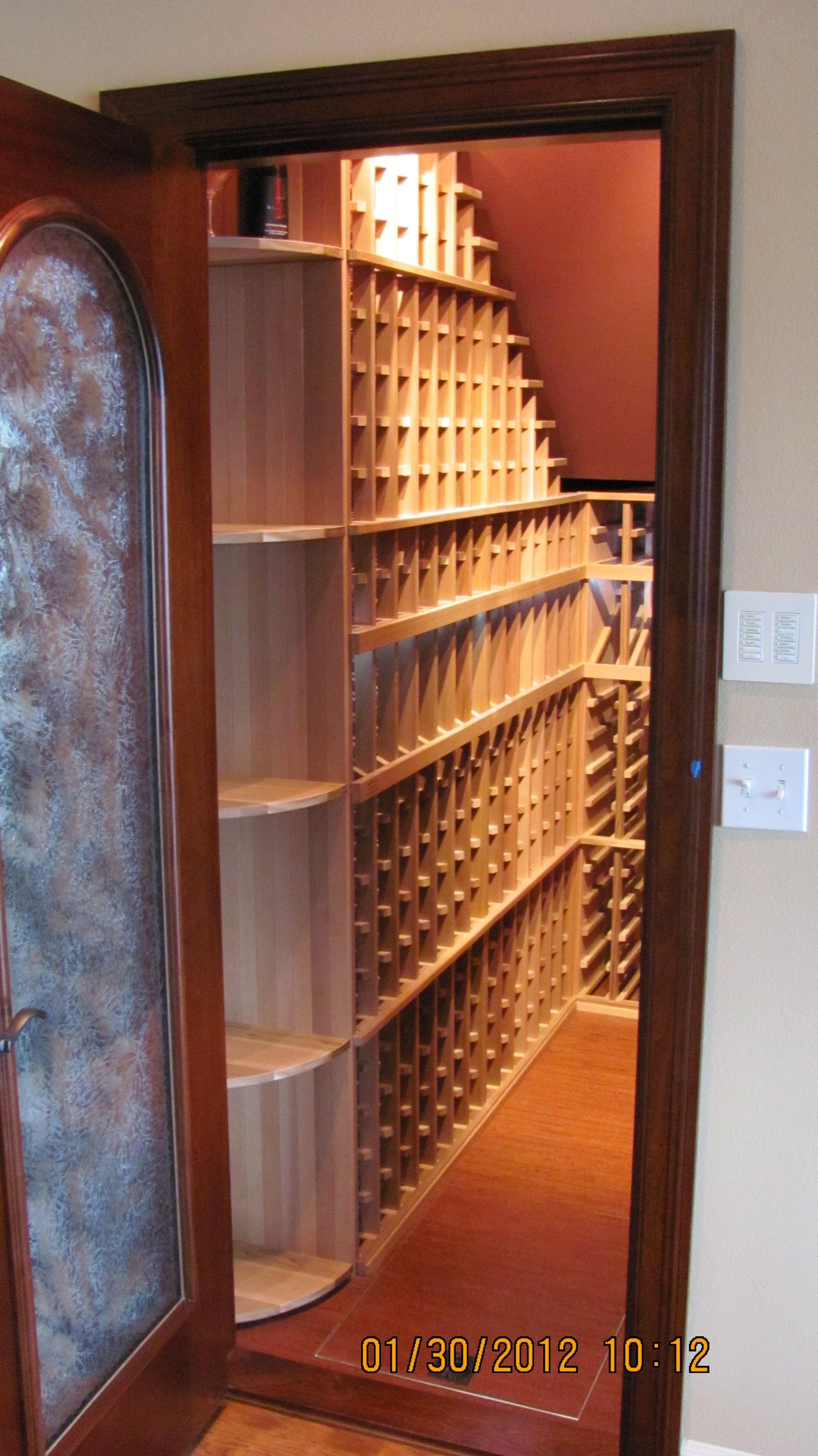 We can find a place to create a wine room, or wine cellar. This is under the stairs with a tilted display row and rope lights. Check out www.reasonableracks.com