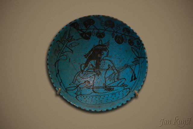The celebrated faience plate with the depiction of a female lute player and a monkey. New Kingdom, XVIII Dynasty, reign of Amenhotep III (1386-1349 BCE), provenance unknown. Faience.