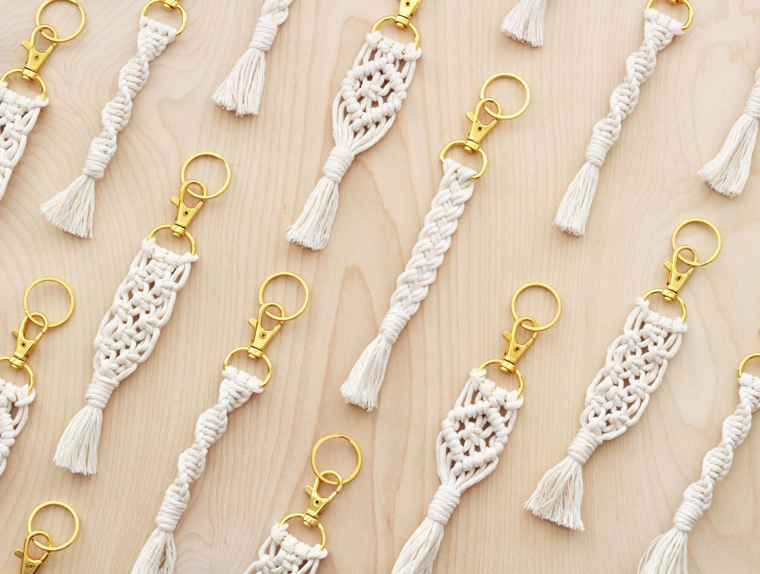 These macrame keychains are handcrafted from soft white cotton cord and attached to a gold swivel snap hook. Also included is