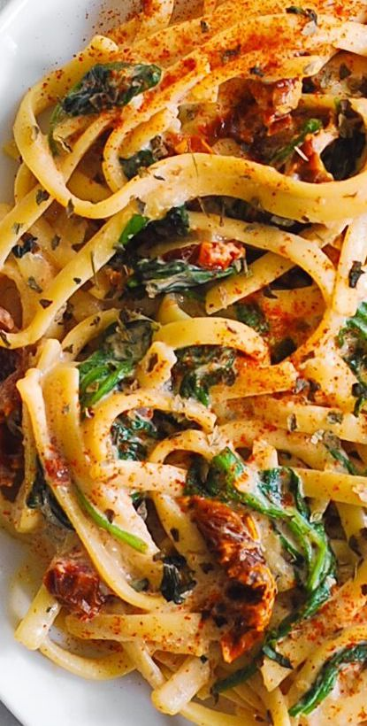 Italian Linguine with Spinach and Sun-Dried Tomato Cream Sauce takes just 30 minutes to make! This simple Italian pasta is a great choice for a weeknight dinner! Linguine is generously coated in a comforting creamy sauce made with garlic and Parmesan cheese.