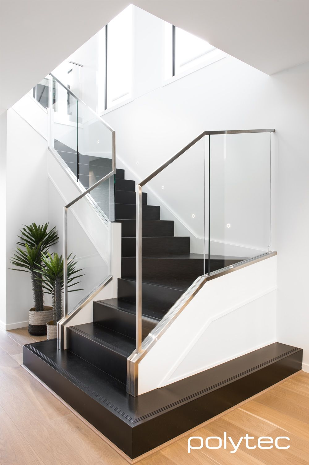 Finished Interior Designs In Kerala: Stylish Modern Stairs In Black Valchromat Finished With A