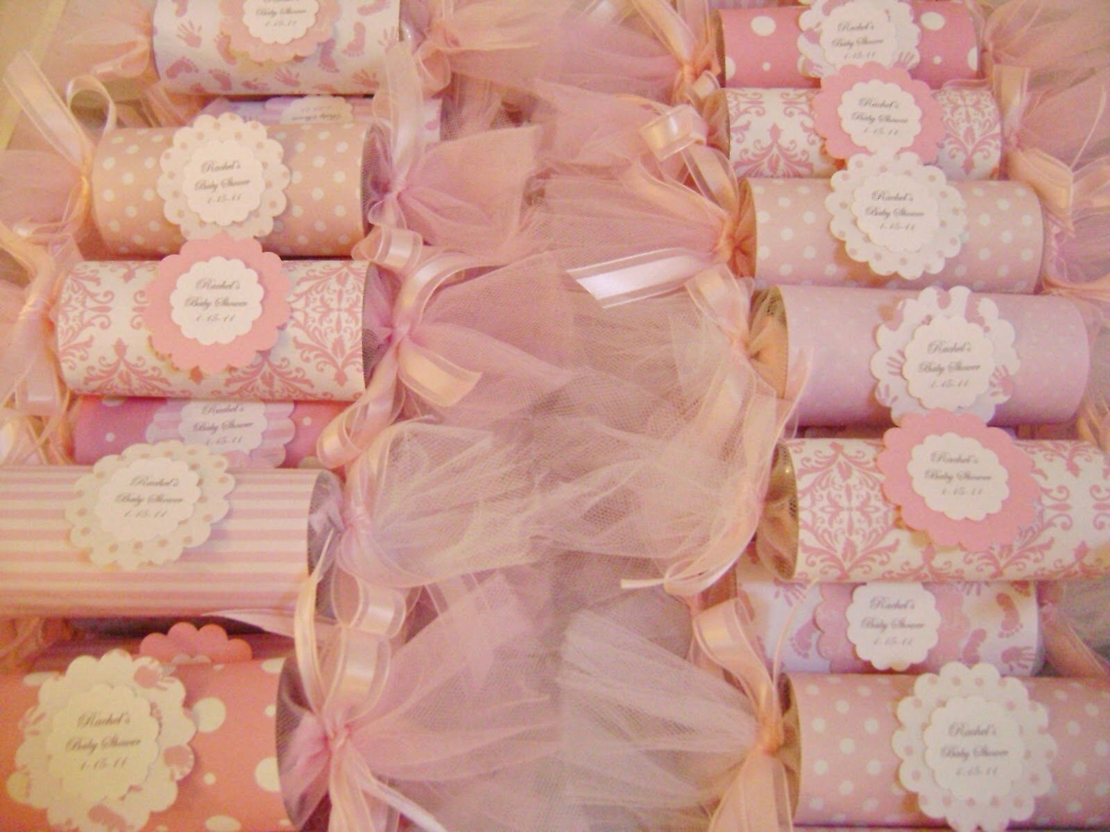 pink baby shower centerpiece wrap toilet paper rolls and fill with candies wrapped in tulle. Black Bedroom Furniture Sets. Home Design Ideas