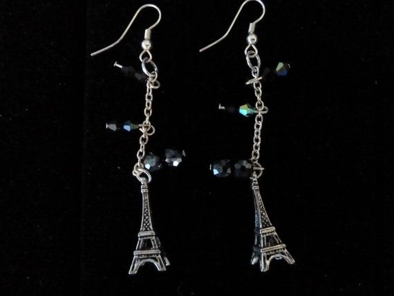 Charm earrings with eiffel tower charms and midnight blue beads on Etsy, $35.00