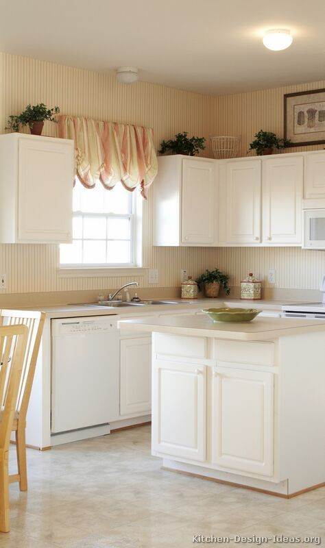 Traditional white kitchen cabinets with white appliances for Traditional painted kitchens