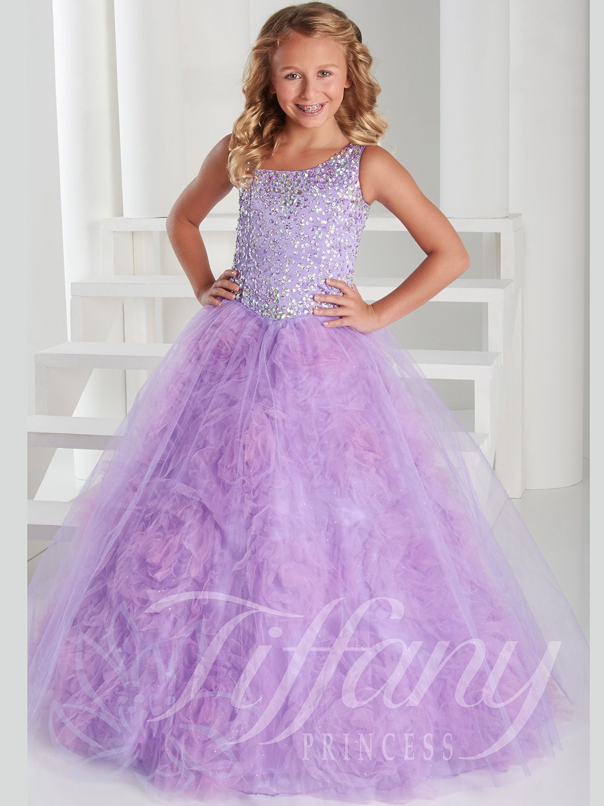 d4f567cdc52a2 Time for your girl to shine bright like a diamond in front of the judges! Tiffany  Princess 13413 is a pageant ball gown featuring a subtly slanted neckline  ...