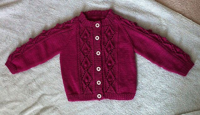 Design F - Lace Cardigans pattern by Sirdar Spinning Ltd