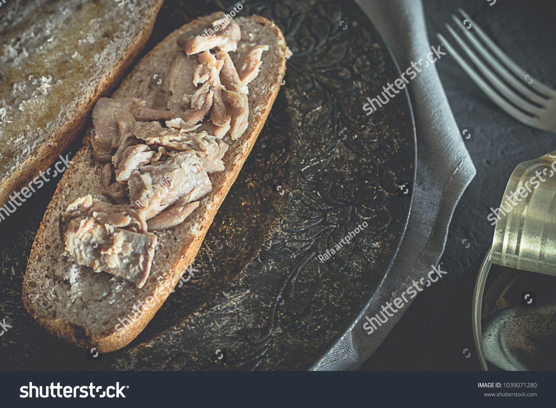Tuna sandwich with whole wheat bread, healthy food, black
