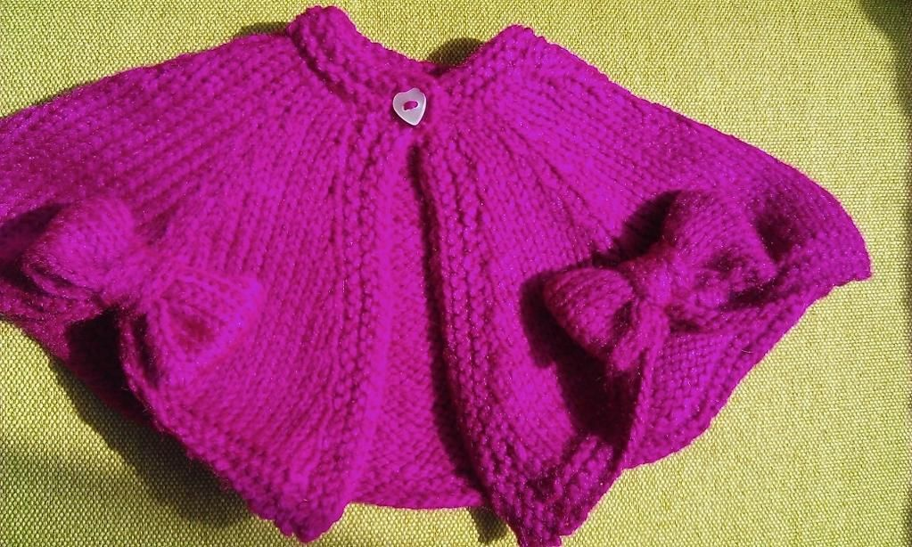 (6) Name: 'Knitting : Baby Fairytale Bow cape - pattern $3