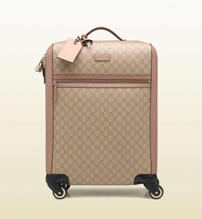 Le più belle Borse da Viaggio Gucci per Uomo e Donna Borse da viaggio Gucci  uomo donna trolley 096359e265d