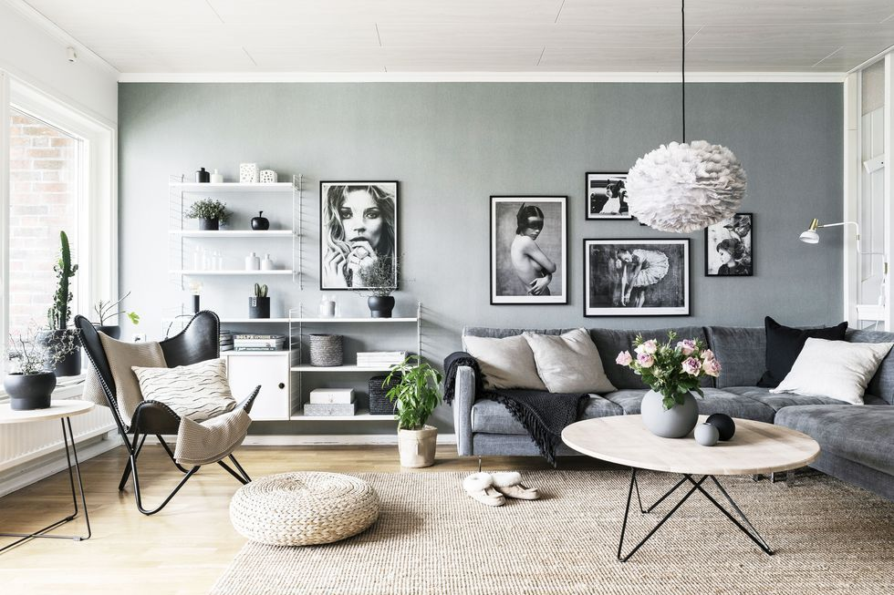 scandinavian living room black and white pictures of mister in different poses instead - Scandinavian Living Room