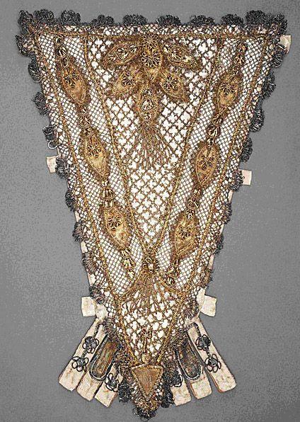Stomacher.  France.  1700-1750.  Silk satin with metallic-thread lace, silk and metallic-thread plain-weave appliqués, metallic-thread passementerie, and tassels.